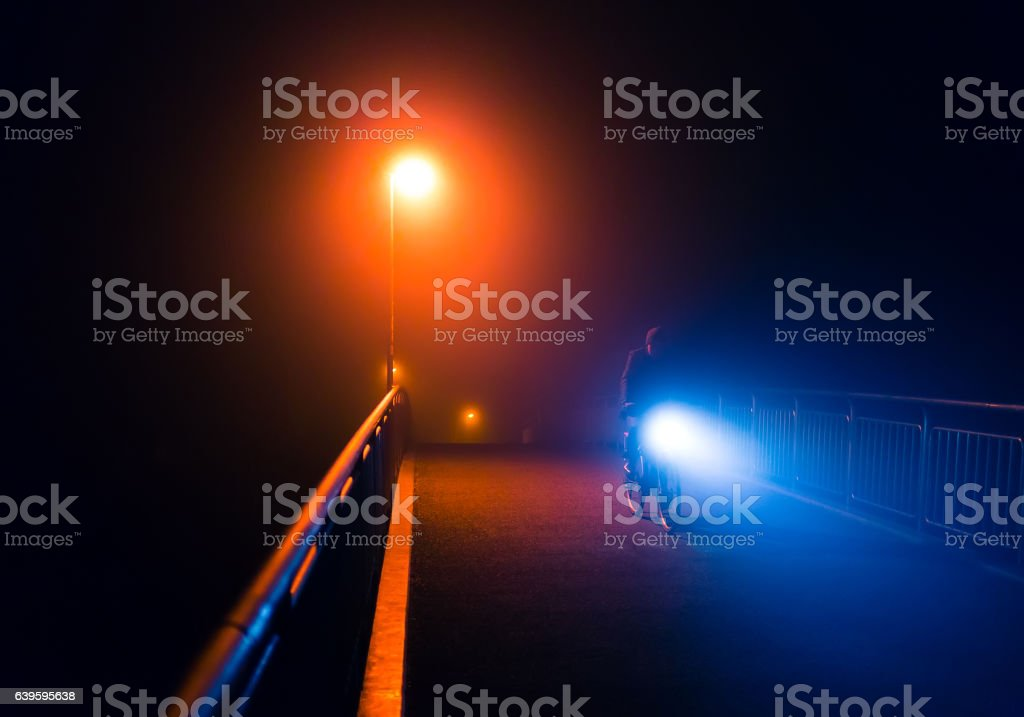 Abstract night foggy walk in city park with streetlights stock photo