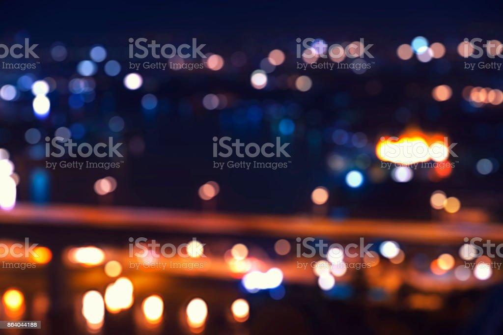 abstract night light bokeh on yellow tone and dark stock photo