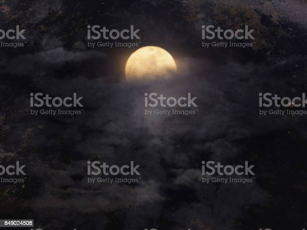 Photo of Abstract night sky with full moon for halloween background.