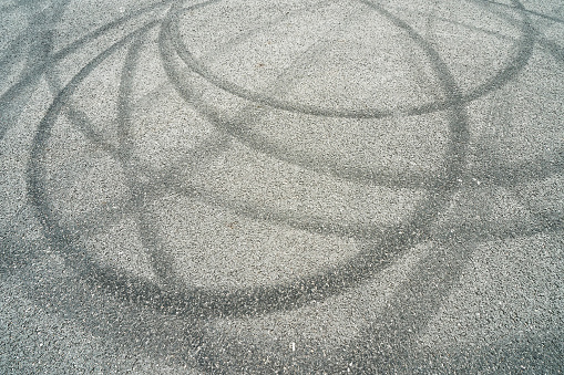 Abstract of Black tire wheels caused by car on the road