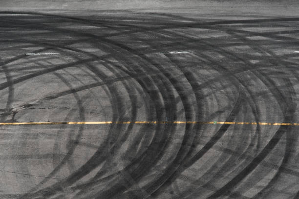 abstract of Black tire wheels caused by Drift car on the road stock photo