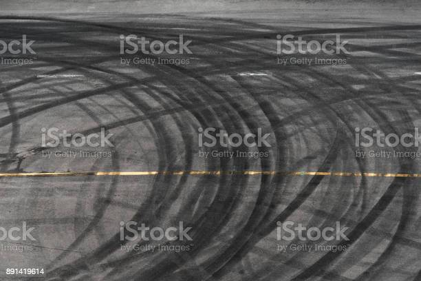 Photo of abstract of Black tire wheels caused by Drift car on the road
