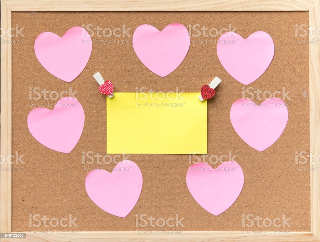 Abstract Of Blank Paper Heart Pin On Cork Board Texture For Add Text