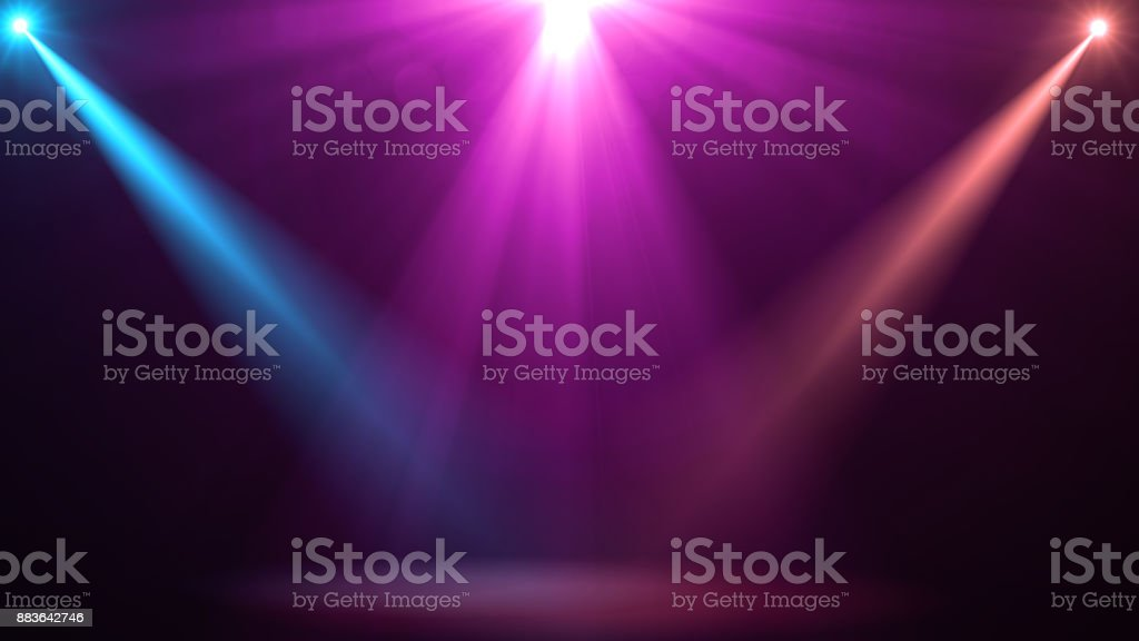 abstract of empty stage with colorful spotlights or Several bright projectors for scene lighting effects . can be used for display or montage your products stock photo