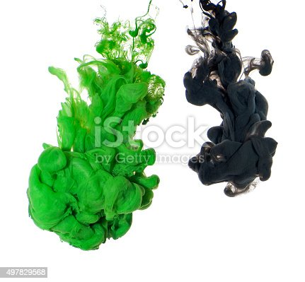 istock Abstract of green and black acrylic paint in water. 497829568