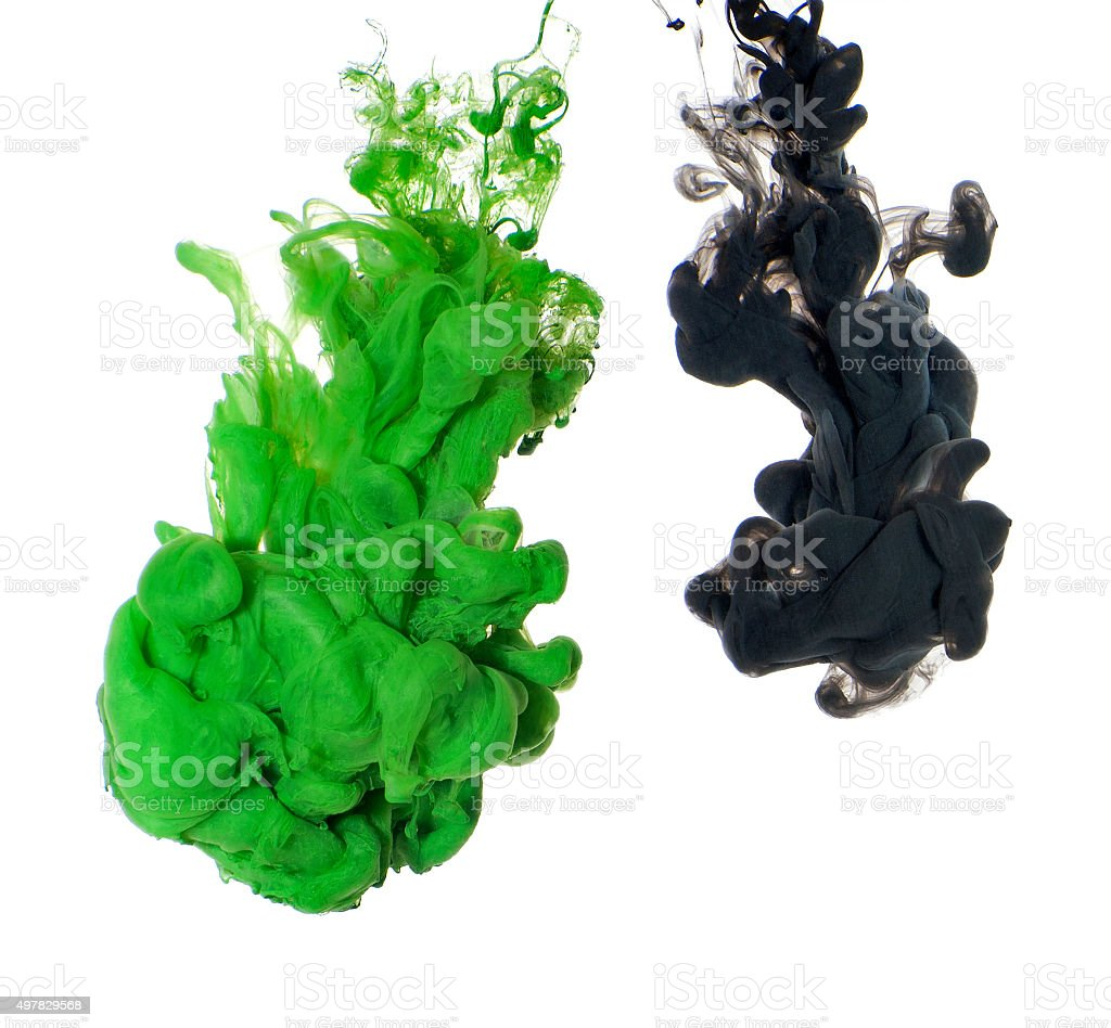 Abstract of green and black acrylic paint in water. stock photo