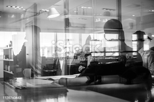 istock Abstract office workers in the meeting 1125740843