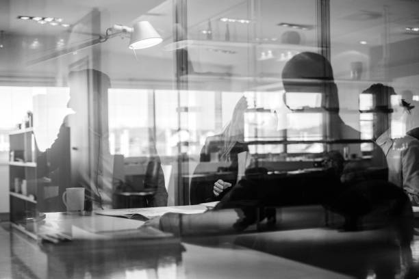 Abstract office workers in the meeting Abstract office workers in the meeting, in camera reflections without any post. monochrome stock pictures, royalty-free photos & images