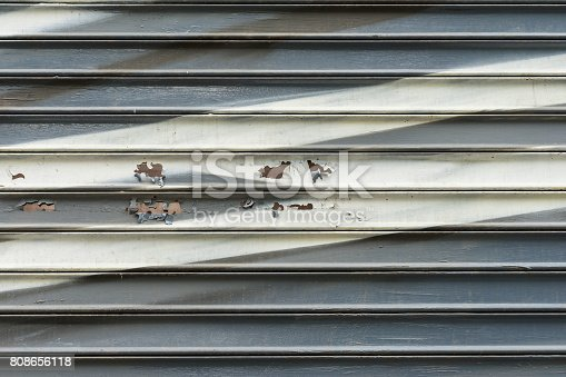 istock Abstract old damaged wall wooden slats with cracks and shabby paint. Pale shades and tones of textured background with space for copy text 808656118