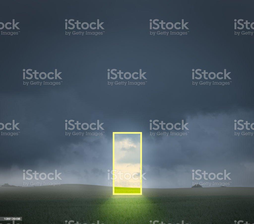 Abstract open door / portal on field stock photo