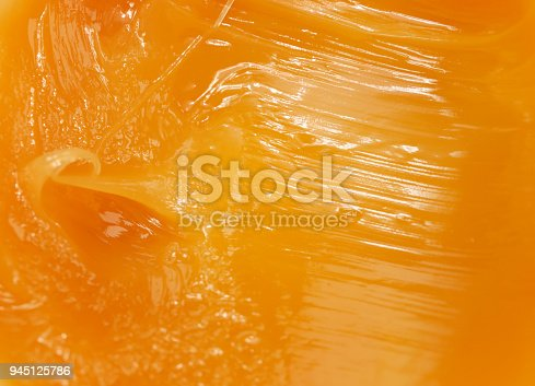 istock Abstract orange textured background 945125786