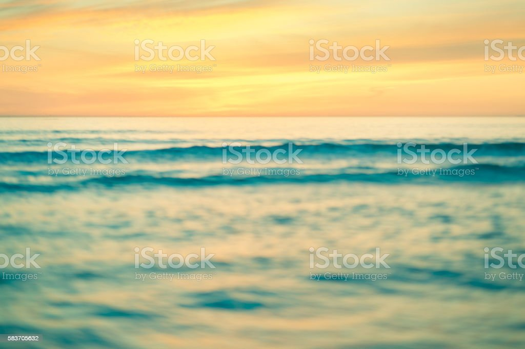 Abstract overexposed toned image of sunset over ocean stock photo