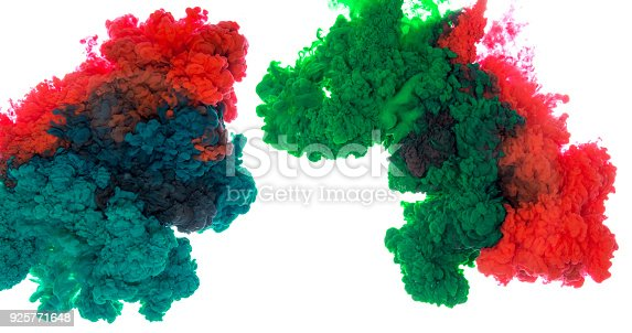 istock Abstract paint background multi color ink splash in the water isolated on white background 925771648