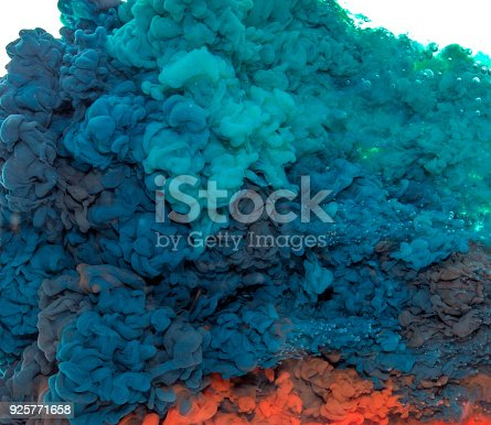 istock Abstract paint background multi color ink splash in the water isolated on white background 925771658