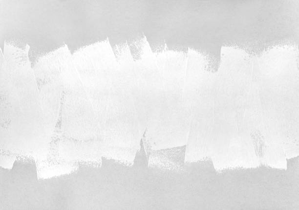 abstract paint roller brush strokes on gray paper stock photo
