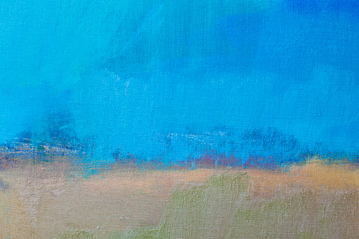 Abstract, blue and beige painted background texture.