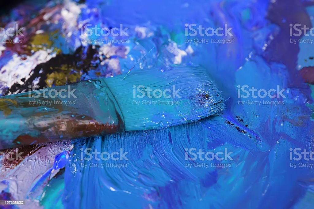 Abstract painted  blue pallet with brush. royalty-free stock photo