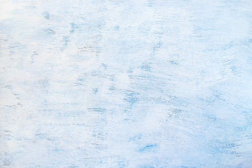 Abstract painted light blue background. Blue wooden texture.