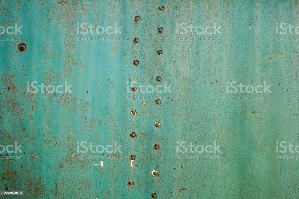 Abstract painted matte green metal background texture with rivets. stock photo