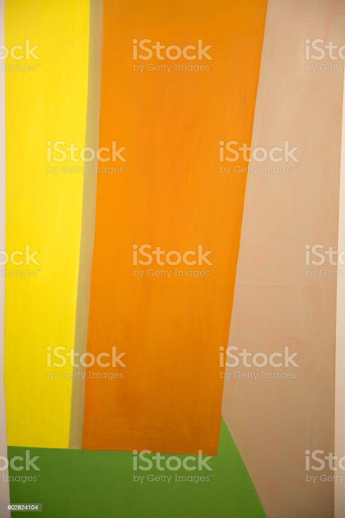 Abstract Painting Art with Yellow, Orange and Green Geometric Shapes stock photo