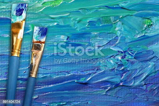649470770istockphoto Abstract painting with paint brushes 591404724