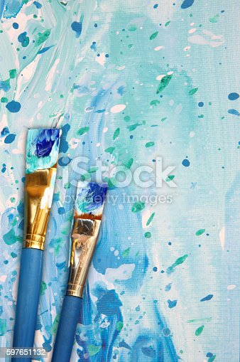 649470770 istock photo Abstract painting with paint brushes 597651132