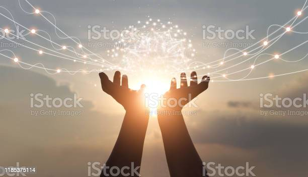 Photo of Abstract palm hands holding global network connections, innovative technology in science and communication concept.