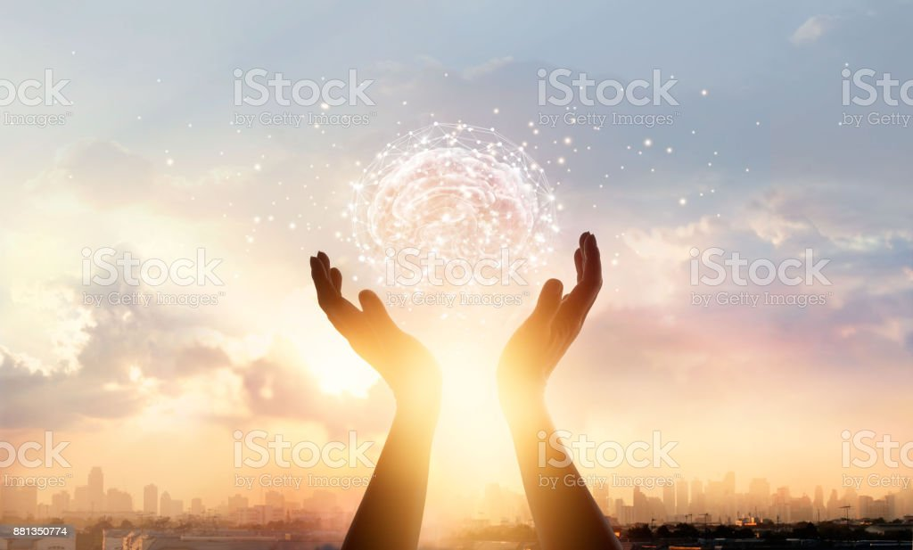 Abstract palm hands touching brain with network connections, innovative technology in science and communication concept stock photo
