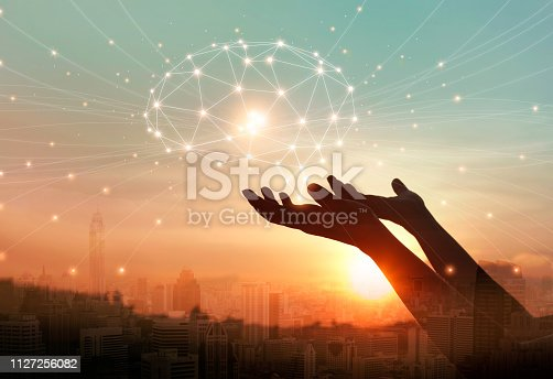 istock Abstract palm hands touching digital brain with network connections, telecommunication, innovative technology in science and communication concept 1127256082