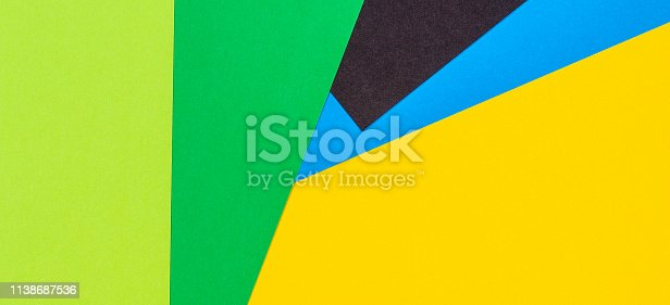 1126531335 istock photo Abstract paper banner background with yellow green blue and black colors 1138687536