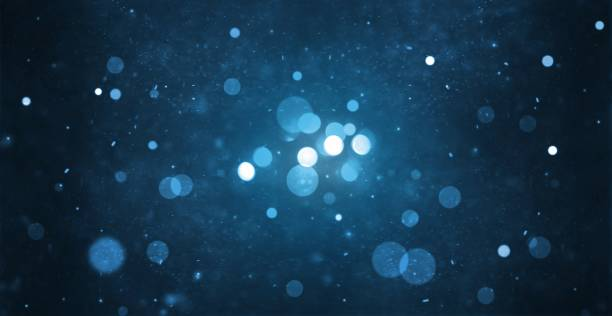 abstract particle bokeh with dark blue background - light effect stock pictures, royalty-free photos & images
