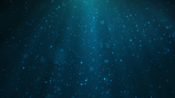 Abstract particles background of shining, sparkling blue particles. Beautiful blue floating dust particles with shine light. 3D Rendering stock photo