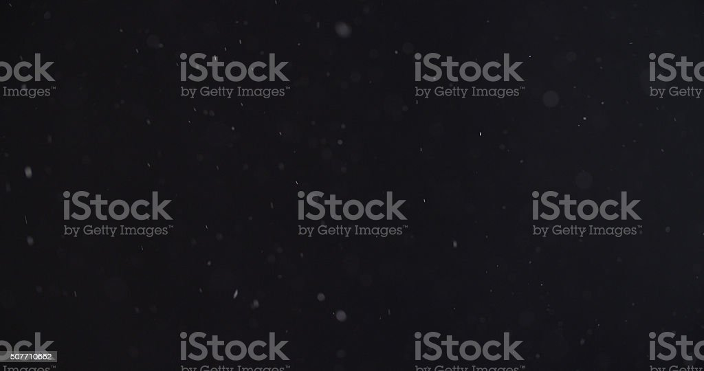 abstract particles flying over black background stock photo