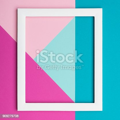 istock Abstract pastel colored paper texture minimalism background. Minimal geometric shapes and lines composition with empty picture frame. 909279708