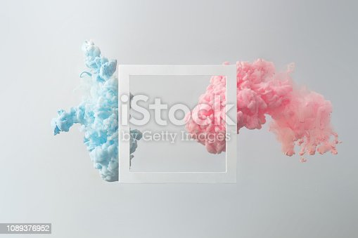 istock Abstract pastel pink and blue color paint with pastel gray background. 1089376952