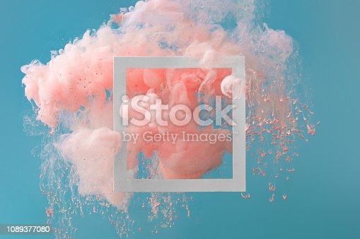 istock Abstract pastel pink color paint with pastel blue background.. 1089377080