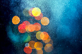 Water dust in motion like snow and defocused lights at night. Abstract Background