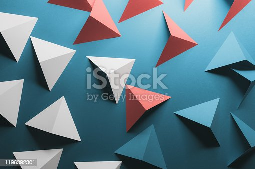 1126531335 istock photo Abstract pattern made of colored paper, blue background 1196392301
