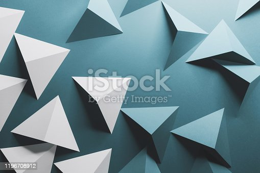 1126531335 istock photo Abstract pattern made of colored paper, blue background 1196708912
