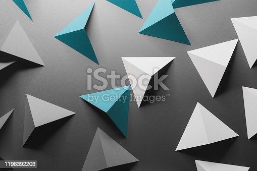 1126531335 istock photo Abstract pattern made of colored paper, gray background 1196392203