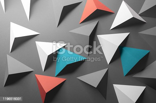 1126531335 istock photo Abstract pattern made of colored paper, gray background 1196518331