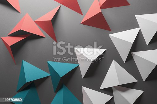 1126531335 istock photo Abstract pattern made of colored paper, gray background 1196708860