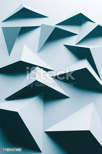 1126531335 istock photo Abstract pattern made of colored paper, light blue background 1195447485