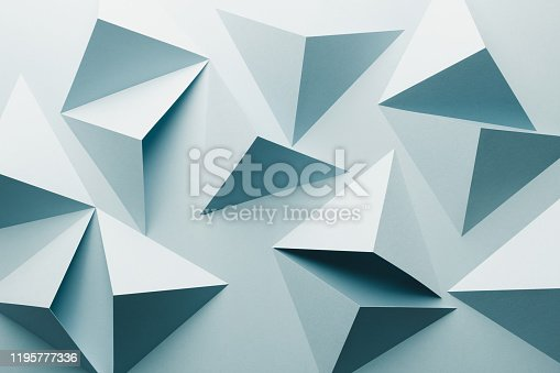 istock Abstract pattern made of colored paper, light blue background 1195777336