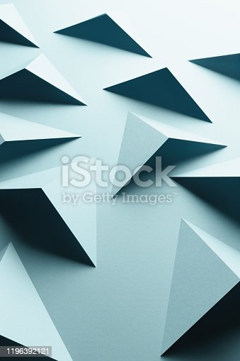 1126531335 istock photo Abstract pattern made of colored paper, light blue background 1196392121
