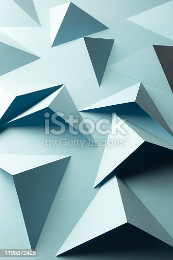 1126531335 istock photo Abstract pattern made of colored paper, triangular shapes 1195372428