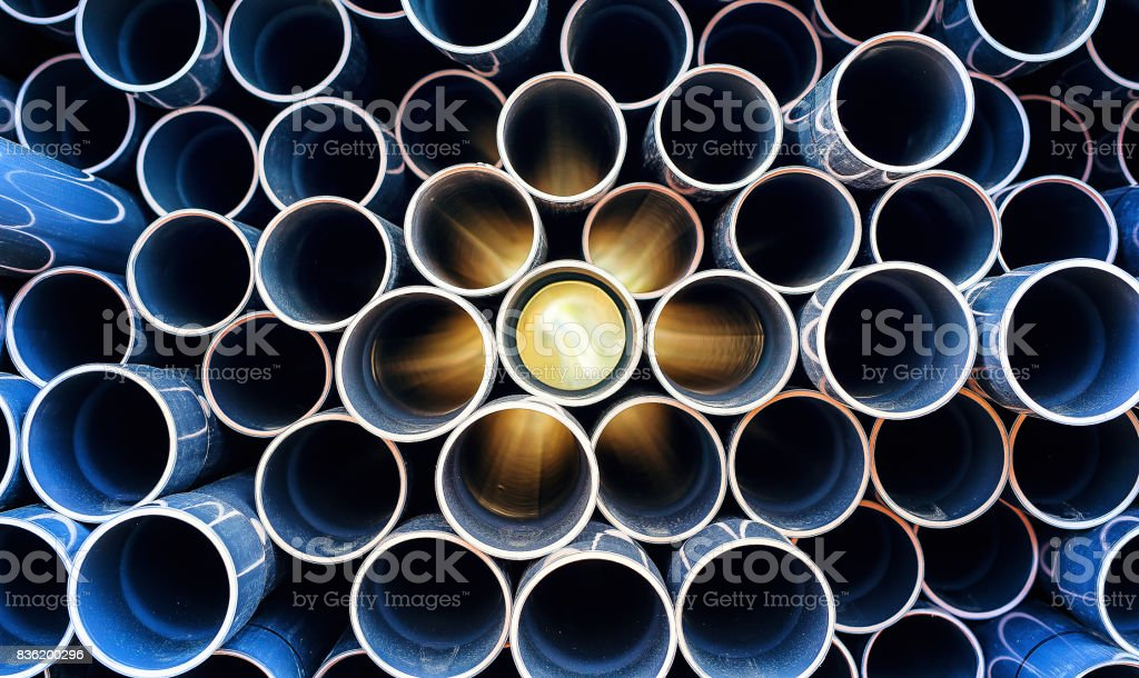 abstract pattern of aged pvc pipe with sun lights stock photo
