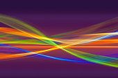 Abstract pattern of intertwined colorful light beams