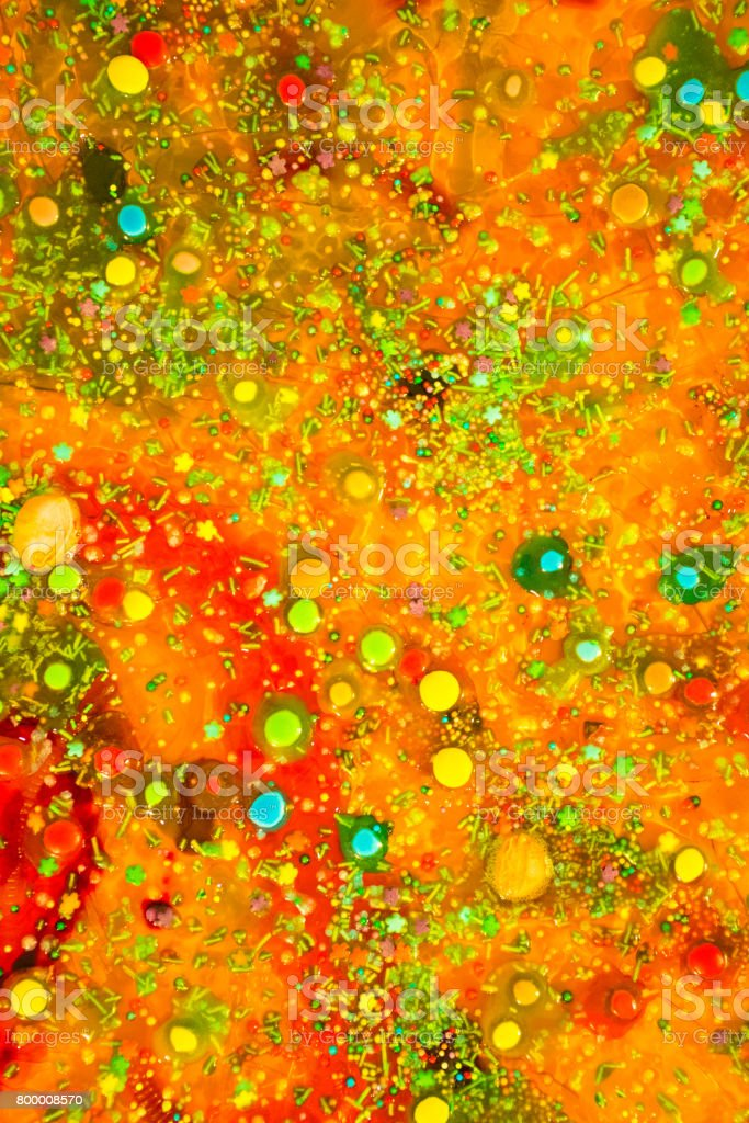 Abstract patterned background from multi colored sweet candies in...