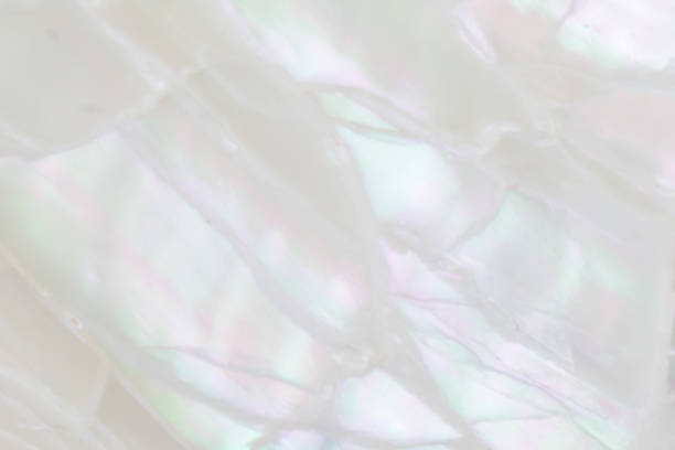 Abstract pearl background with soft shimmering mother of pearl lilac and rainbow colours Abstract pearl background with soft shimmering mother of pearl lilac and rainbow colours inlay stock pictures, royalty-free photos & images